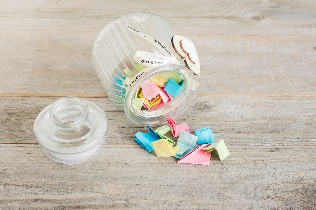 Jar filled with colorful pieces of paper