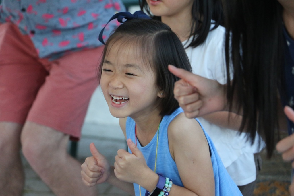 A camper giving two thumbs up at Camp Korey, the SeriousFun camp in Washington